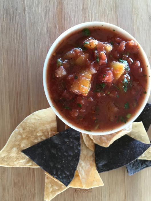 Homemade tortilla chips and fresh bowl of salsa