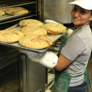 Taking Fresh baked pies out of the oven